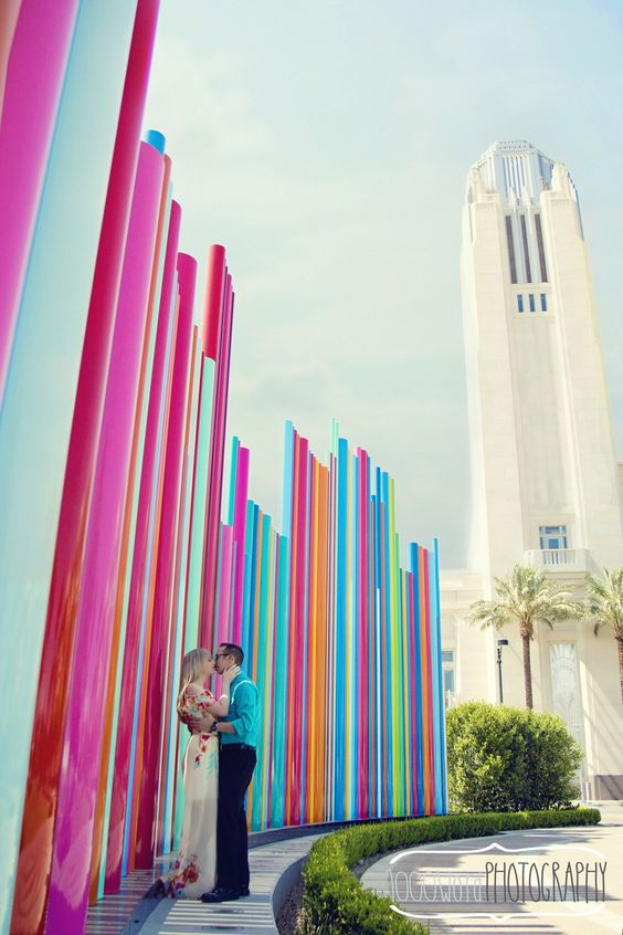 A cute engagement against the colorful backdrop of The Smith Center by 1000 Word Photography via Little Vegas Weddings.