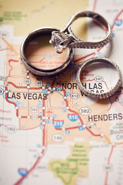 Love the wedding set, the map idea with the rings, and also the location. Read this guide on how to get married in Vegas!