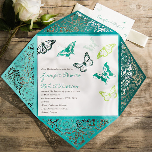 Laser cut wedding invites with butterflies.