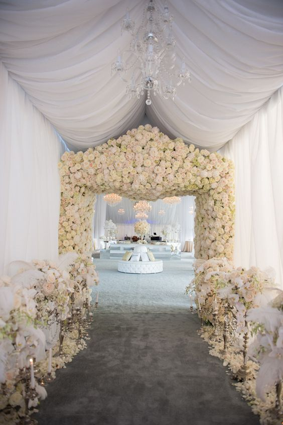 This is what I call an entrance! Fabric, flowers and a delicate chandelier make the difference. The Biltmore Estate, in Asheville, North Carolina.