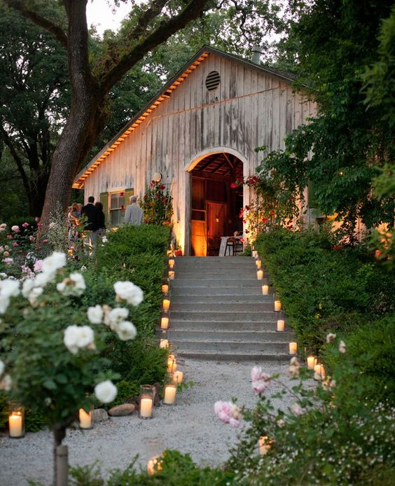 Wedding reception idea using candles to light up a flight of stairs by Todd Events.