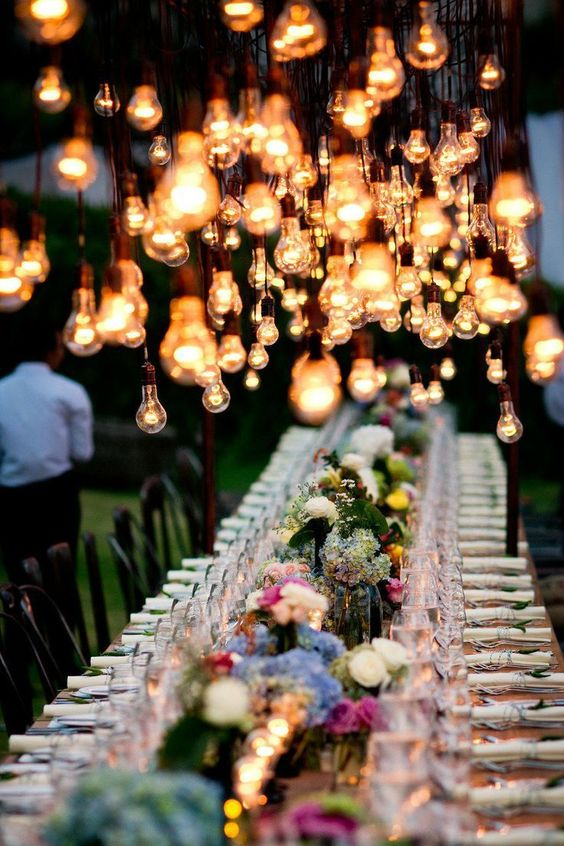 Boho wedding. Nothing transforms your reception table ambiance more than the right lighting.