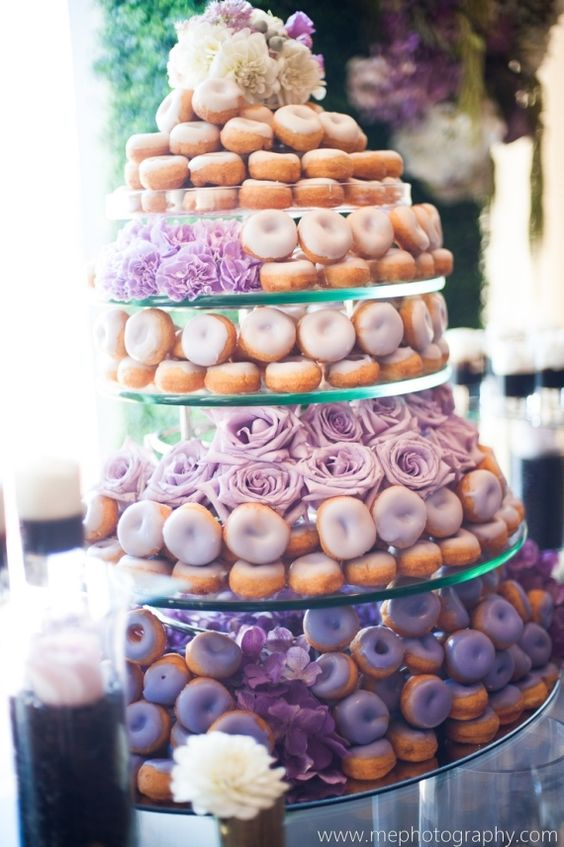 Donut cakes are becoming more and more popular for weddings! Match them to your theme with colored frosting. Photography: me photography.