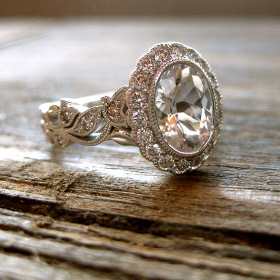 Fine vine oval cut engagement ring with white sapphire and diamonds.