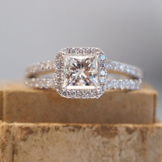 Princess cut Halo engagement ring with split shank in white gold with micropave diamonds.