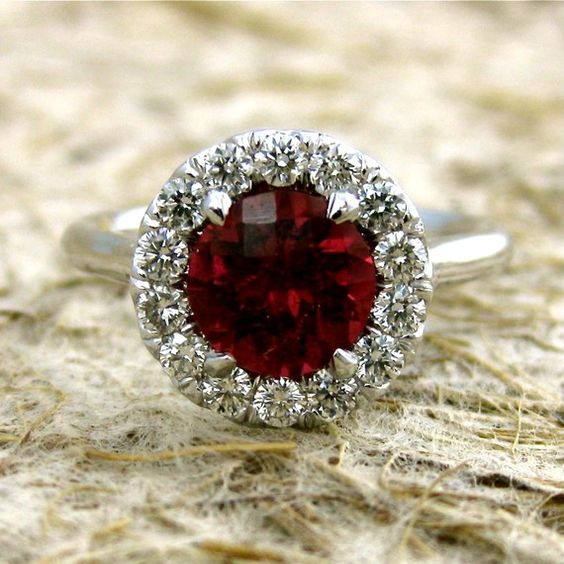 Scarlet red garnet with diamonds in a classically styled, elegant engagement ring.