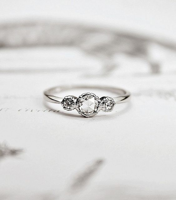 Simple engagement rings are back in fashion because a massive, impressive engagement ring isn't for everyone.