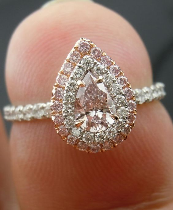 The engagement ring guide to diamond or center stone shapes. Light pink diamond pear shaped engagement ring with double halo.