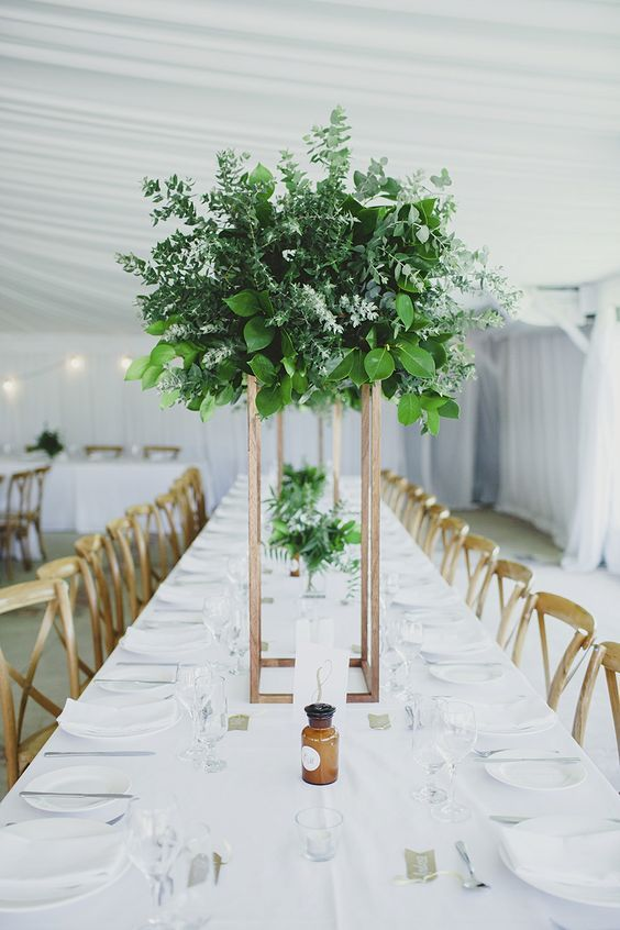 Wedding table ideas you'll love. Tall and modern greenery centerpieces with an edge.
