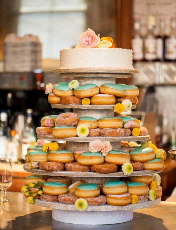 A mix of traditional and funky with this doughnut wedding cake captured by Ashlyn Dawson Photography, Toronto Ontario.