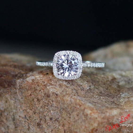 Gorgeous 1ct. Forever One Moissanite surrounded by diamonds Halo engagement ring with round cut center gem. Certificate of Authenticity Ships worldwide from Atlanta, GA.