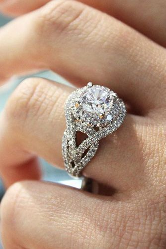 Spectacular halo engagement rings... not just beautiful... they look larger at a lower cost by Reverie.