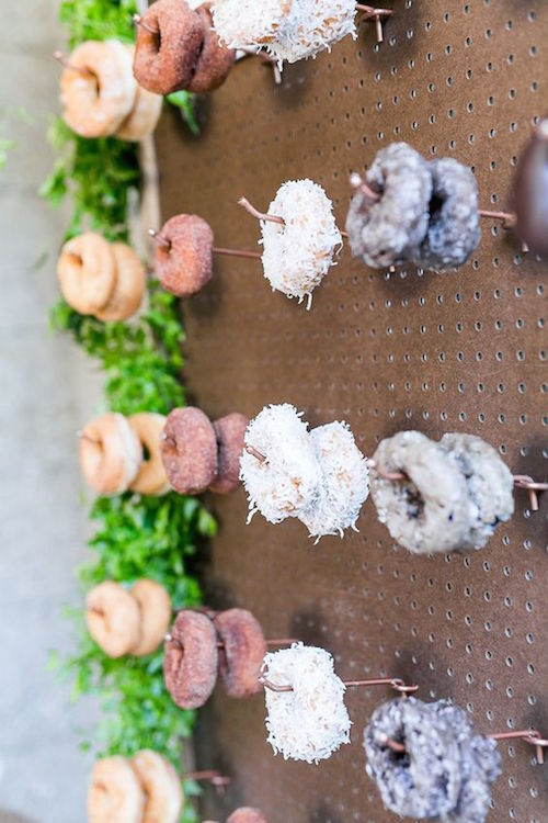 A pegboard wall of donuts! Now this is an affordable, fun and original idea! Who said you have to have cake anyway?