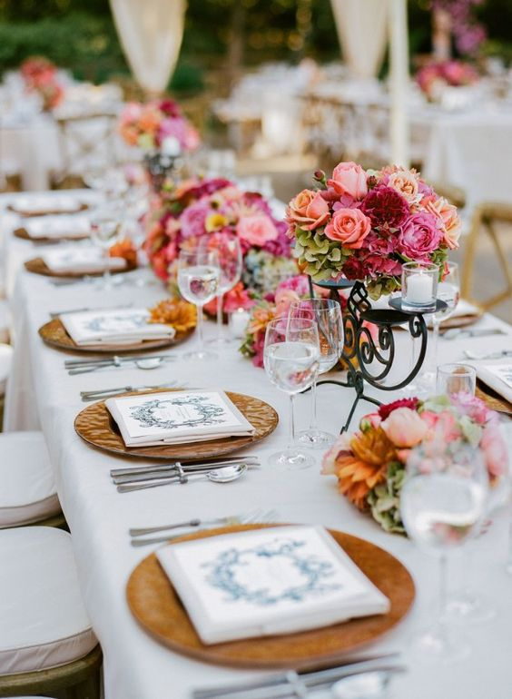 Soften the look of your long tables with round plates and round centerpieces.