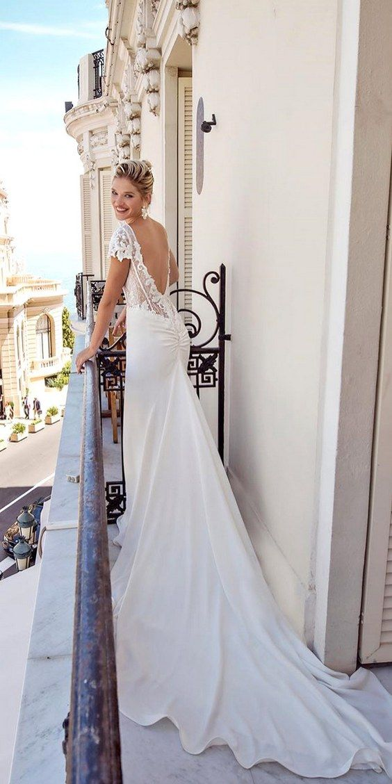 Stunningly beautiful backless dress with a cathedral train by Italian designer Alessandra Rinaudo from her 2017 bridal collection.