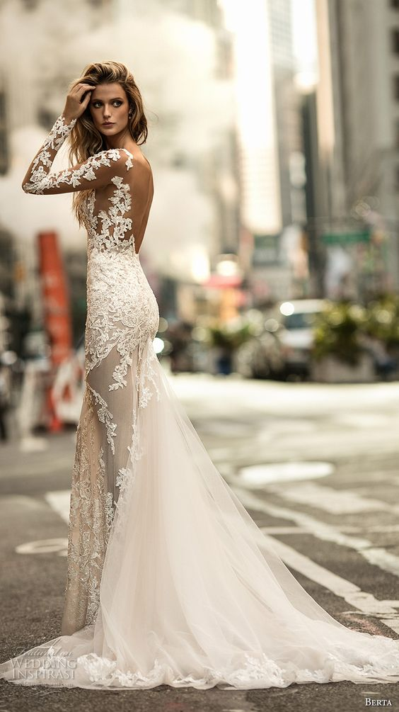 From the Berta Bridal fall 2017 collection let's admire this sexy and elegant long sleeved illusion jewel neckline embellished lace fit and flare wedding dress with a low back chapel train.