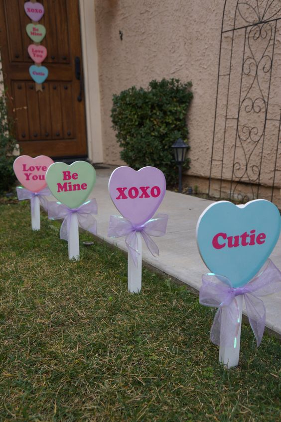Valentine's Day conversation candy heart yard decor.