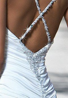 Low back with embellished criss-crossed straps.