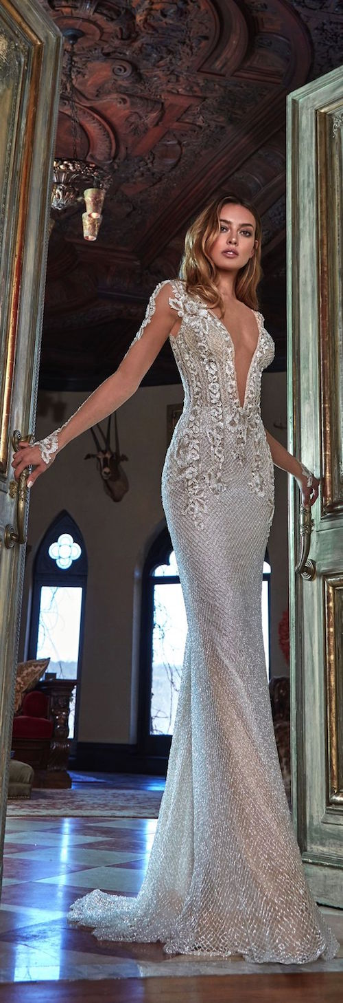 Sexy wedding dresses with illusion sleeves and pluging necklines.