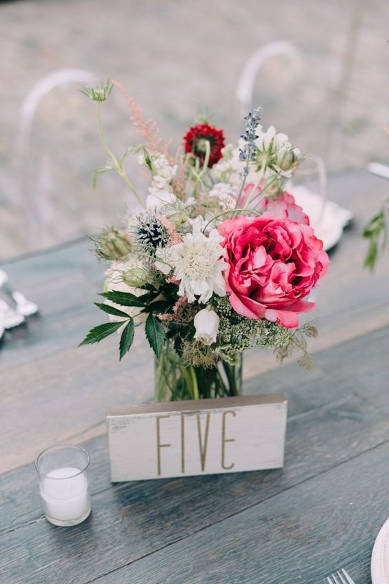 Romantic table numbers and pink floral decor at The Foundry. Photography: Emily Delamater.