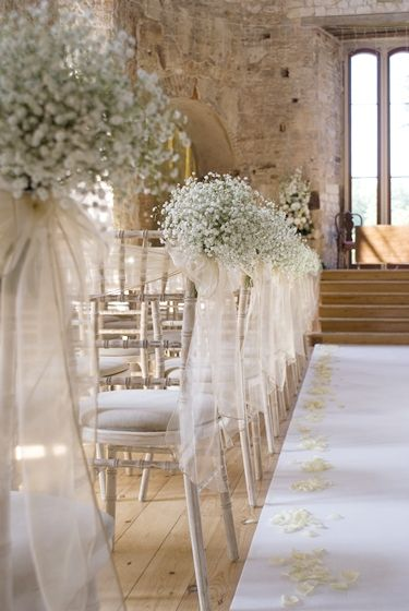 Love the gypsophila down the aisle and the white rose petals.