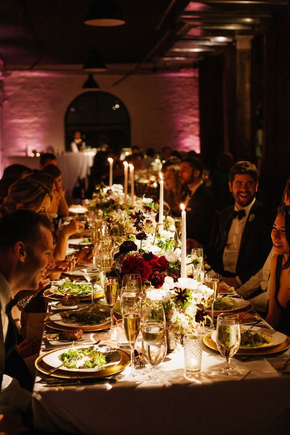 A chic candlelit wedding reception held within an industrial wedding venue in Brooklyn, NY at Liberty Warehouse. Photography: Levi Stolove Photography.