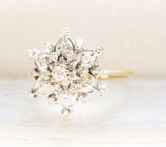 Vintage snowflake diamond ring to show off at your engagement party.