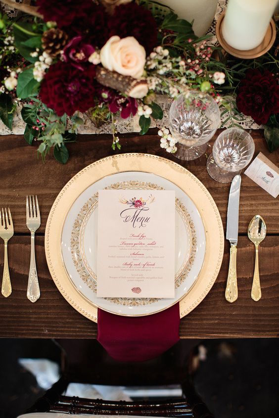 Burgundy, white, and gold fall place setting. Read more about how to set a wedding table on this article. Ashley Cook Photography.