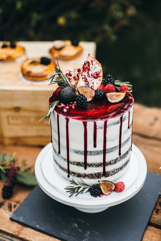 This jaw-dropping cake isn't the only pretty thing on this garden wedding. Image: Emily Kirke Photography.