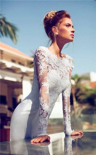 What's more sexy and romantic than a long sleeved vintage lace wedding dress? By Sortra.
