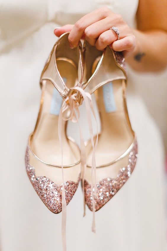 Remember to break in your wedding shoes before the big day. Rose gold wedding shoes.