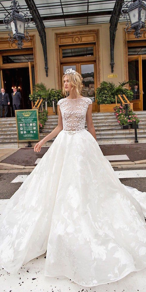 Pair up a sheer lace top with a ball gown skirt for a sexy and, at the same time, demure bridal look. Alessandra Rinaudo Wedding Dresses 2017.