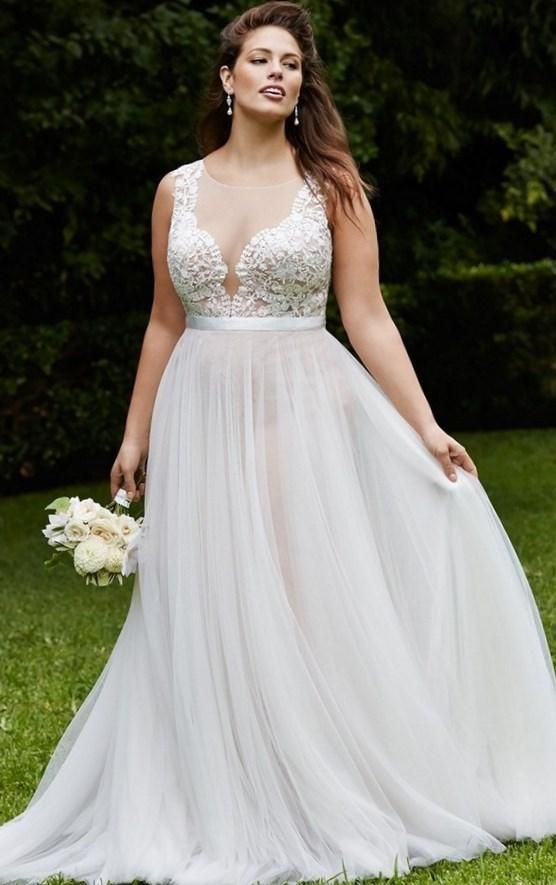 A classy and sexy lace creation for the plus size bride. By David Tutera for David's Bridal Spring Collection.