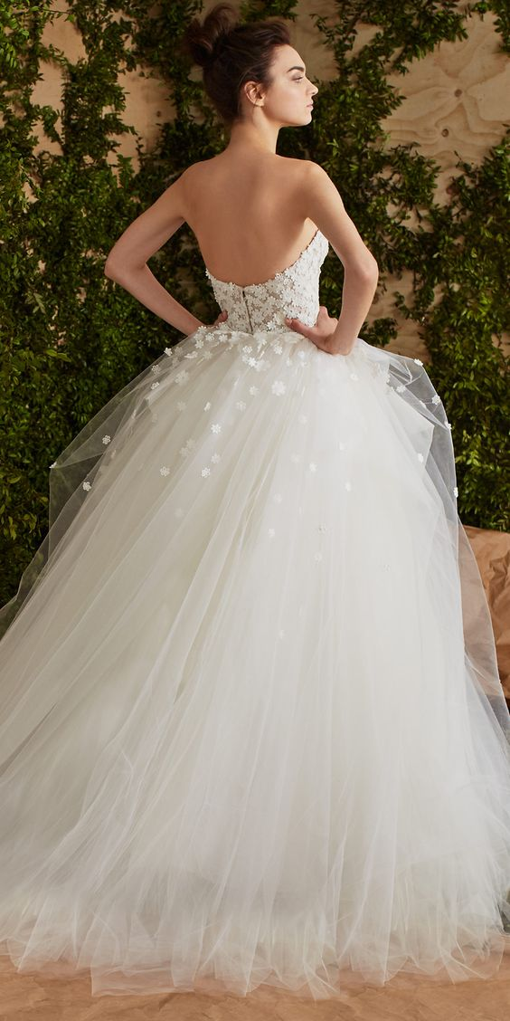 Imagine yourself in this 2017 Carolina Herrera wedding dress amidst the enchanted woodland background.