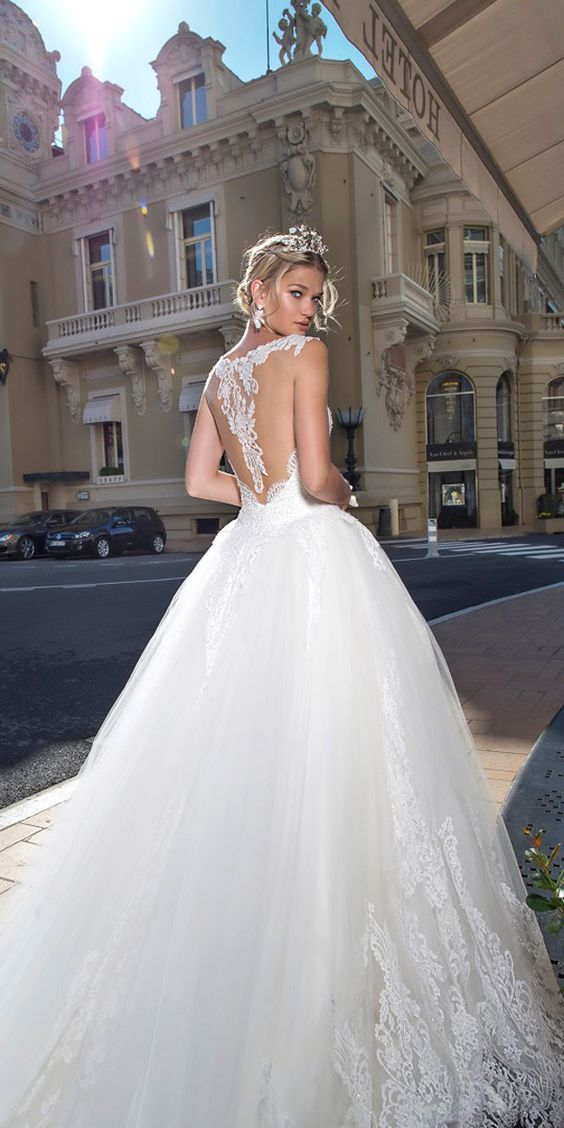 Illusion back with a lace design fit for a princess and an airy and soft layered ball gown skirt. Bonny. Alessandra Rinaudo Bridal Collection 2017.