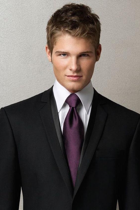 Aubergine groomsmen and groom ties for a black tuxedo.