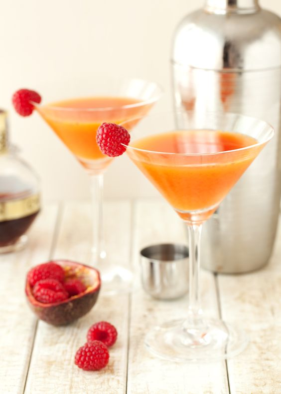 The Blushing Cuban passionfruit raspberry cocktail is a vibrant & exotic blend of fresh passionfruit, raspberries and Cuban rum.
