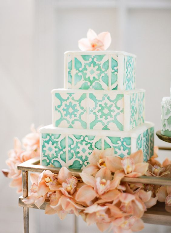 Cuban-inpired wedding cake surrounded by coral flowers. Dreamy! Wedding photographer: Jose Villa Photography.