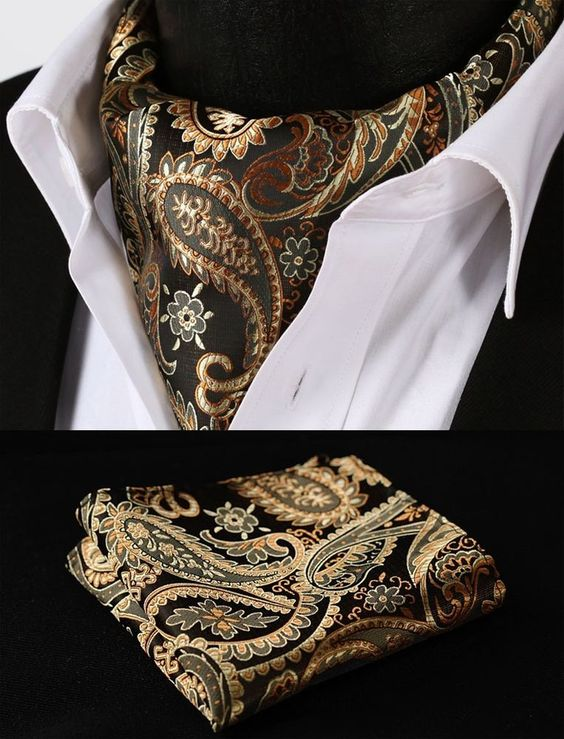 The Euro Tie is a middle ground between the necktie and the Ascot. Gold orange paisley silk cravat.