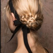 Low braided bun perfect for a French-themed wedding. Oh la! la!