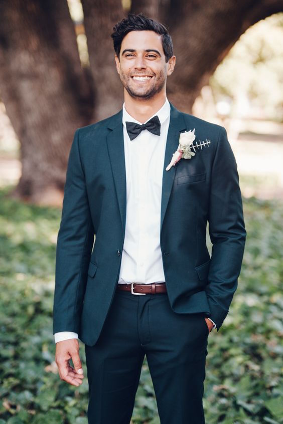 Groom in tuxedo & bow tie. Wedding photographer: Big Love Photography.