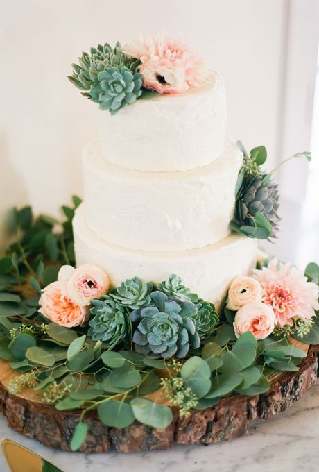 Woodland themed three-tiered wedding cake with ranunculus, anemones, and succulents by The Butter End.