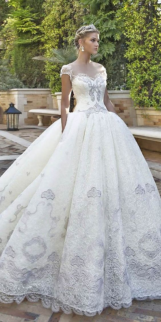 Love the details in color on the bodice and ball gown skirt of Biancamaria. The sleeves are perfectly and effortlessly placed to hold your dress in place and to look like a queen.