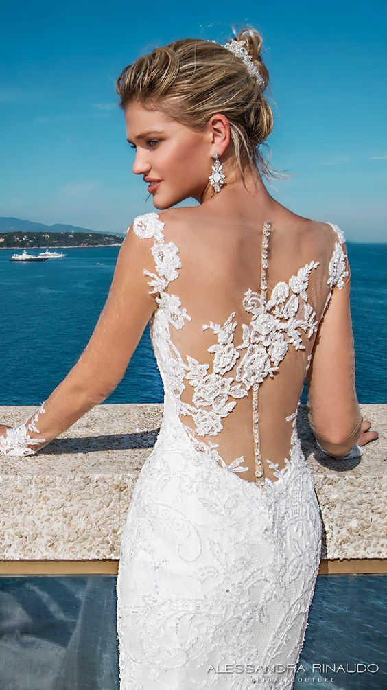 Berenice is a chic and elegant mermaid silhouette wedding dress with illusion sleeves and low back. A long train perfect for a ceremony in the South of France.