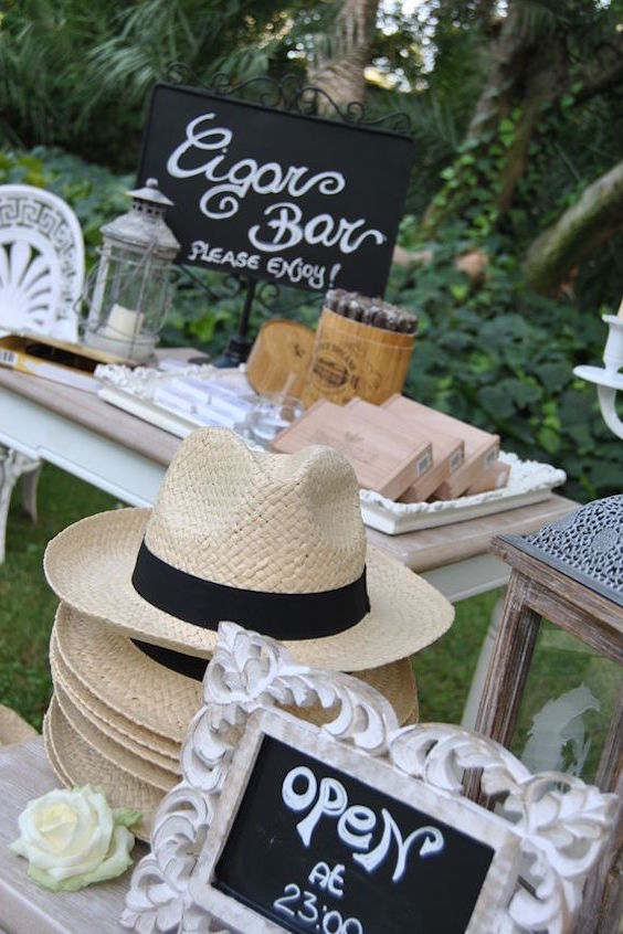 A cigar bar with Fedoras. How cool is this? Wedding photography: Sara events.
