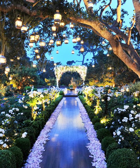 Go over the top with your wedding entrance and create an enchanted garden where no forest exists.