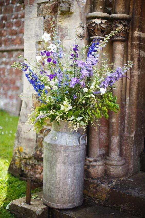Wild flowers and greenery decor. Countryside venue filled with rustic charm.