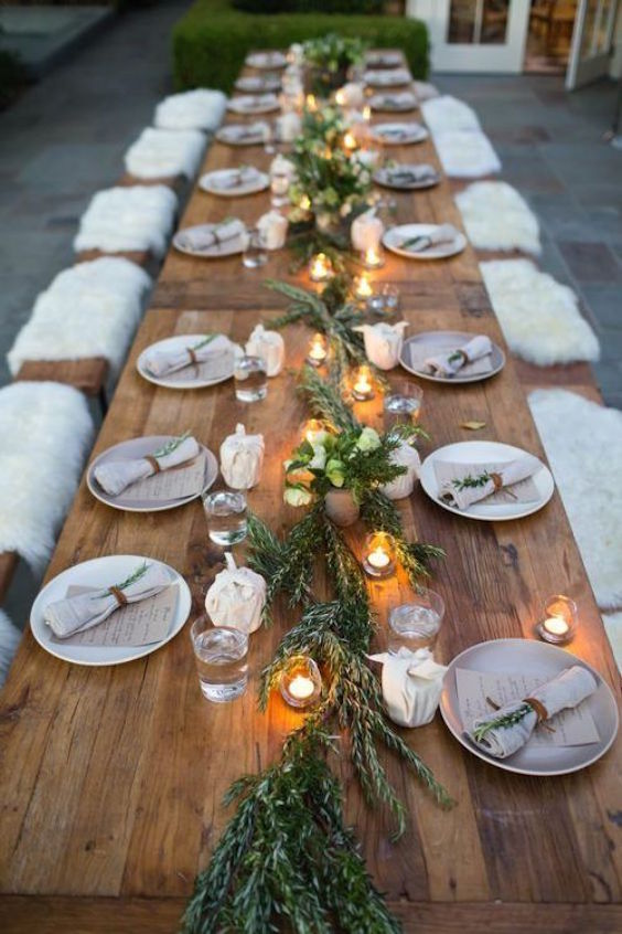 Long table seating somehow spells forest. Bring the outside elements in to keep the cost of decorating down. We love these sprigs of Rosemary tied to the napkins!