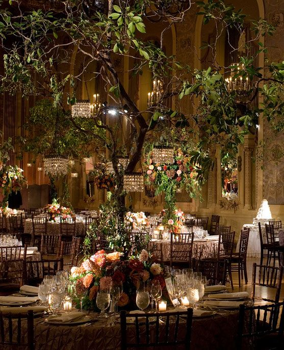 Incorporate a decorated tree to the indoor venue to create a magical forest wedding. Gorgeous!