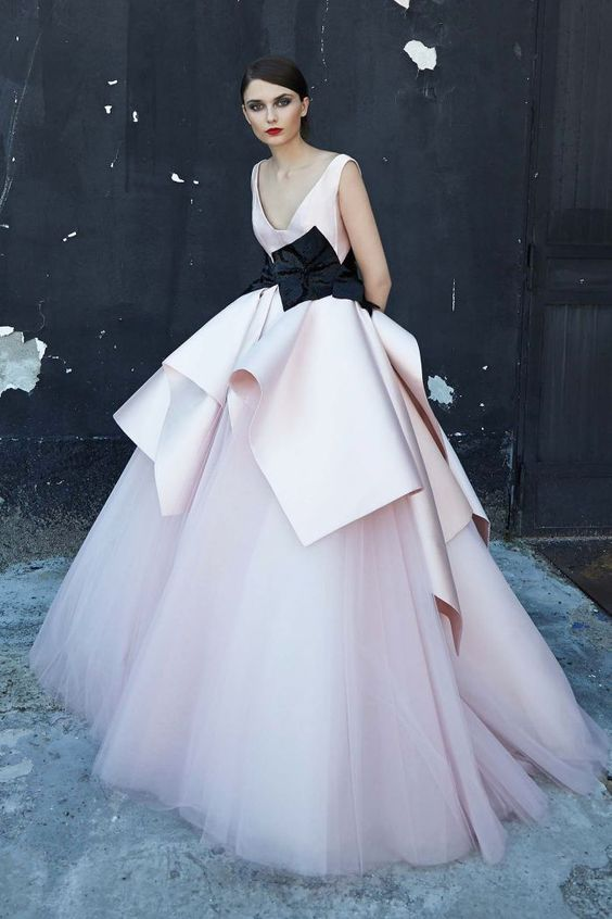 For a very formal affair consider a geometrically shaped pink dress with a black sash belt like this evening gown by Peter Langner, Spring/Summer 2017 Collection.